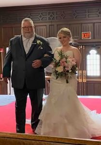 Father and daughter, about to start down the aisle.