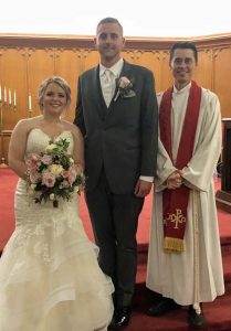 Pastor Rich presents Mr. and Mrs. Melichar, Haley and Conor.
