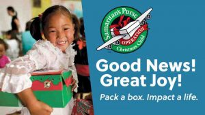 This is a promo photo for Operation Christmas Child pack a shoebox campaign. Features a happy young girl holding her Operation Christmas Child shoebox.