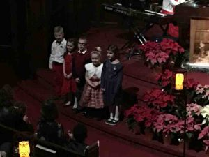 Photo of our youg children singing.